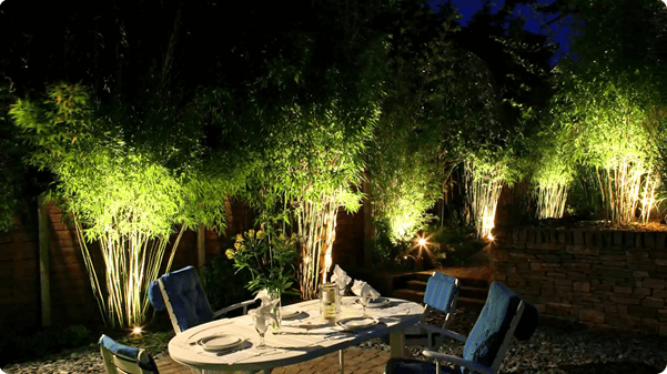 When the sun sets outdoor lighting can create its own dramatic effects by accentuating features such as ponds statues sculptures garden beds and trees